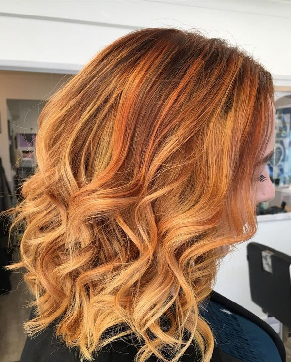 Wavy Red Bob with Highlights